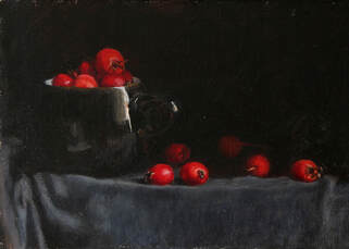 Still life realist oil painting of red berries in a black cup. The berries were found in the Autumn in Kew Gardens. I like to bring natural objects into the studio to paint. Painted in natural light, the red berries glow from within the shadows.