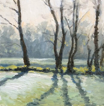 Plein air impressionist realist landscape oil painting of a frosty morning in Orleans gardens Twickenham.  The bright frosty morning created strong tree shadows across the grass, bright sunlight shining through hazy distant trees.